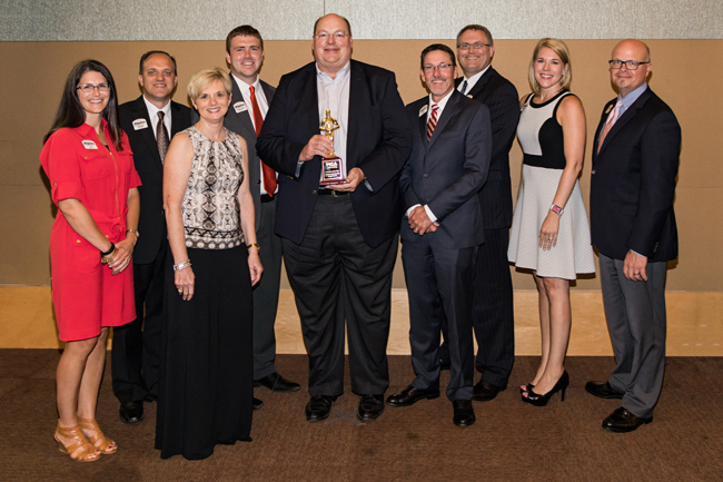 Dupaco group poses with the Dubuque Chamber's Business of the Year award.