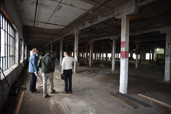 Voices project participants assess the building's dilapidated fifth floor interior.