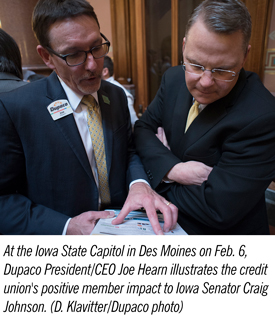 At the Iowa State Capitol in Des Moines on Feb. 6, Dupaco President/CEO Joe Hearn illustrates the credit union's positive member impact to Iowa Senator Craig Johnson.