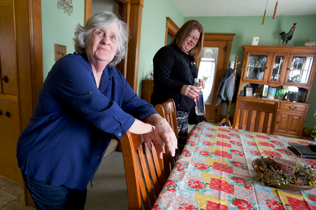 Dupaco member Linda Jackson with Dupaco representative Jacki Clausen during a visit to Linda's Morley, Iowa home on March 16. During an on-site education event in Anamosa, Iowa earlier this year, Dupaco helped Linda Jackson realize a savings of $20,000. This helped ensure she is able to keep her home after the death of her partner, Tom, last year. (M. Burley photo)