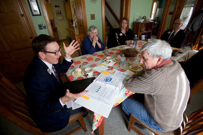 Dupaco member Linda Jackson shared her story with several employees and Iowa State Rep. Andy McKean during a visit to her home in Morley, Iowa—population 112.