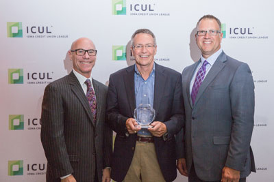 Gregg Liddle (center) of Dupaco receives the 2015 Professional Cooperative Spirit Award.  Pictured with Patrick S. Jury (left), President/CEO of the Iowa Credit Union League, and David Cale (right), Chairman of the Iowa Credit Union League.